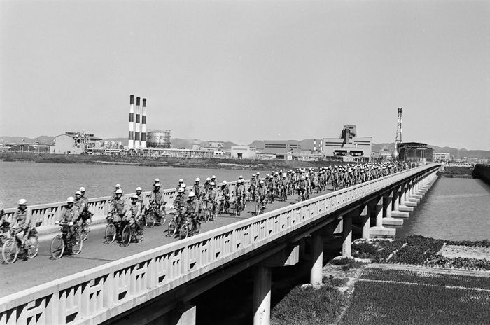 POSCO employees riding a bike to work in the 70s