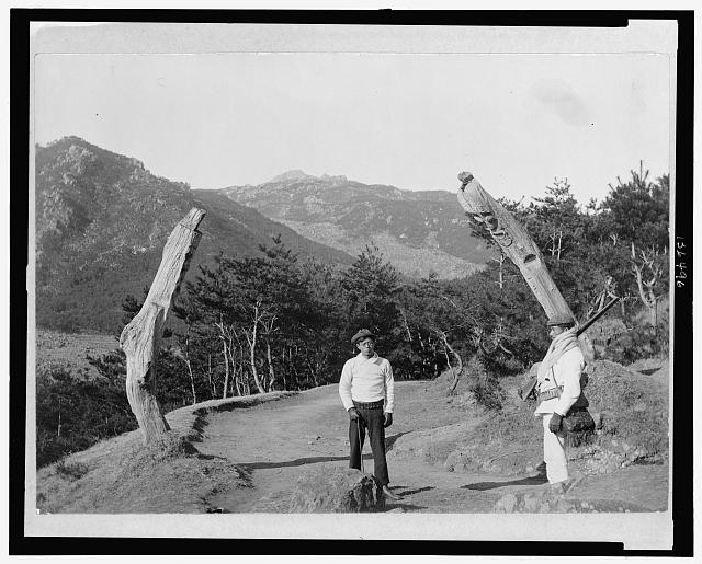 posts on road carved to prevent evil spirits from passing