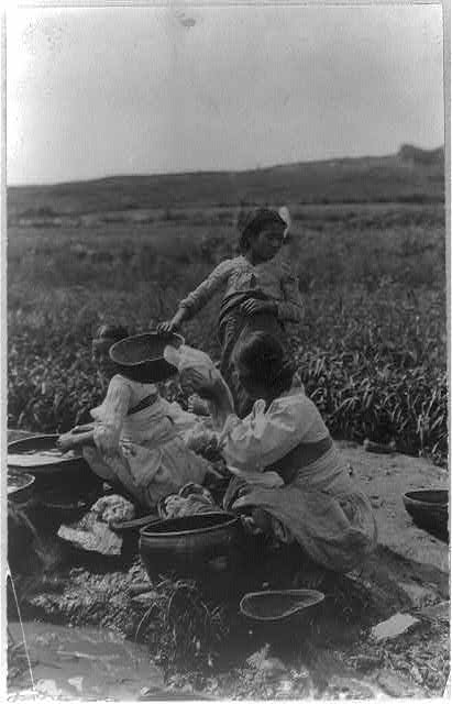 women washing clothes outside